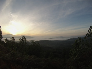 Sunrise from the hill, with the mist rolling over the Jungle.